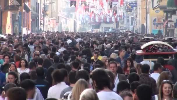 People walk through the shopping street