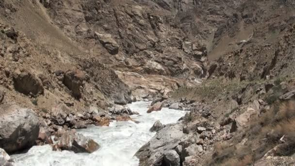 A river separates Tajikistan from Afghanistan