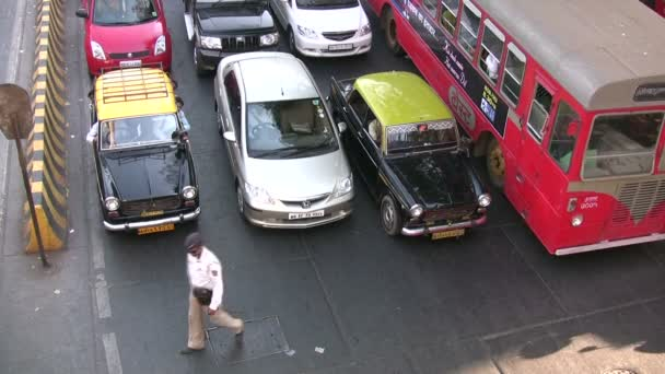 A police officer guides traffic in Mumbai
