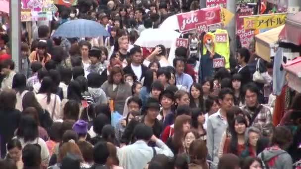 people walk through shopping street