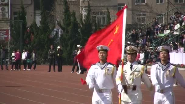 Chinese students carry the national flag