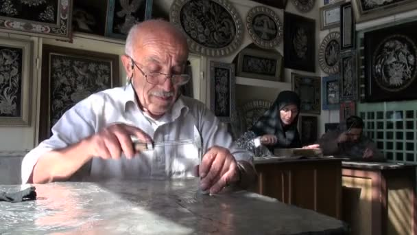 An artisans make silver ware