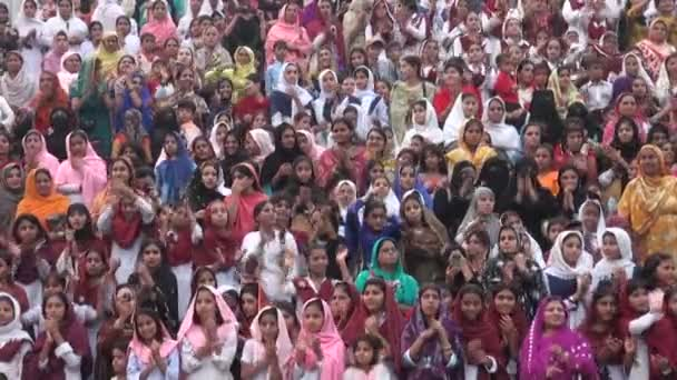 Crowds of women dressed in traditional dresses