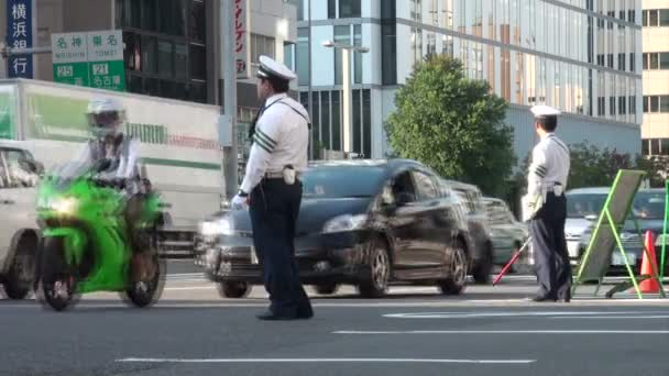 police officer guides the traffic
