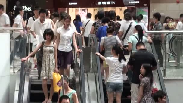 People going up and down escalator