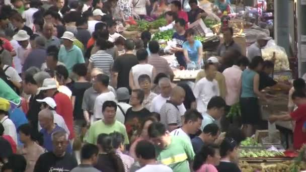 People buy groceries at market