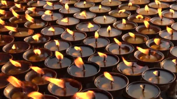 Flames of candles near the Boudhanath stupa