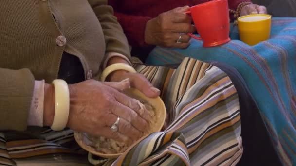 Kneading tsampa, the traditional Tibetan staple
