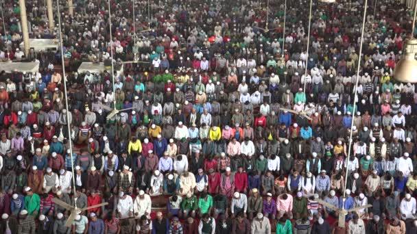 men attend Friday prayer