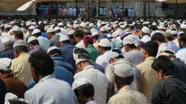 men take part in prayer session inside mosque