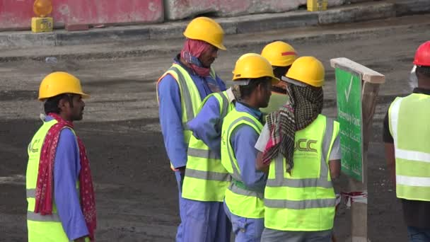 Migrant workers on road building site