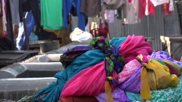 Men cleans clothing at the Dhobi ghats