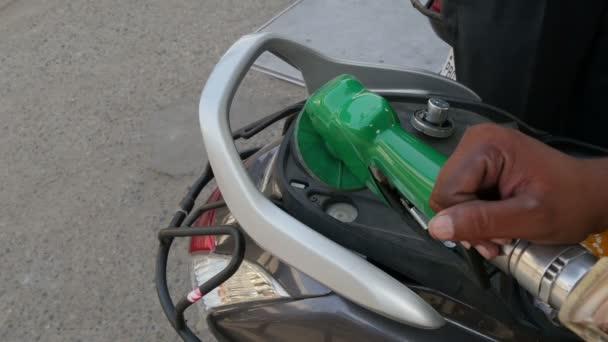 A fuel hose pumps petrol