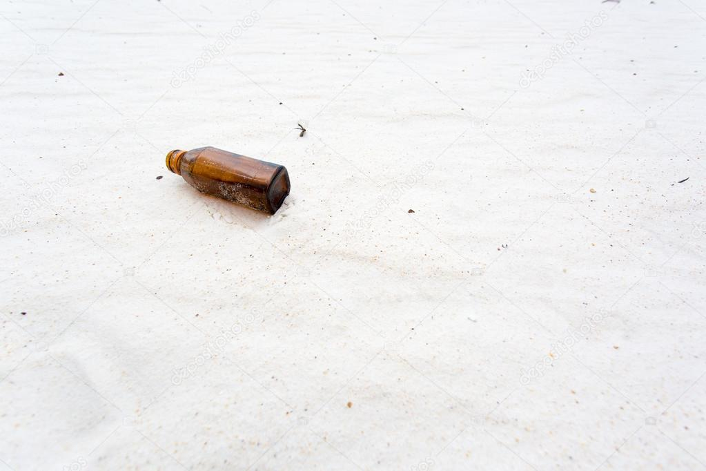 bottle on the clean sand beach