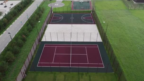 A view from above at the sports grounds: tennis, volleyball, basketball, football and a workout area in the cottage village, play and training, doing sports