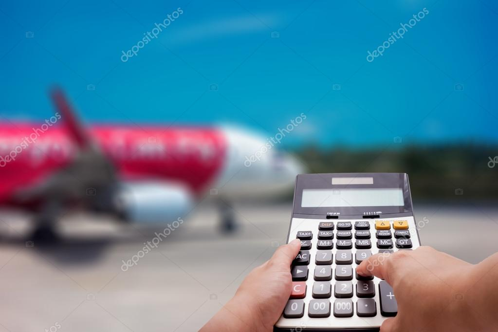 travel cost calculation concept by calculator and airplane in
