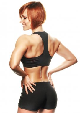 Back view of fit female athlete against of white background