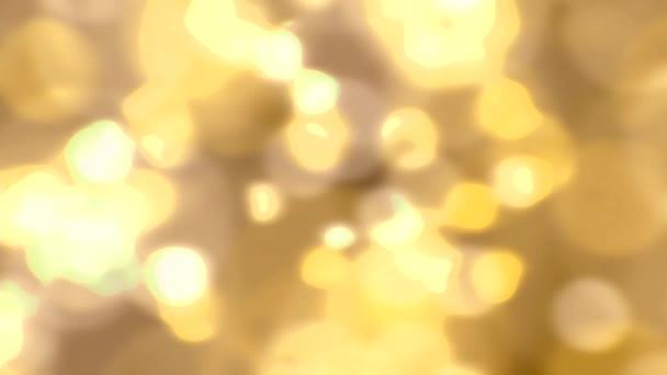 Sparkling light sparks slow motion defocused abstract background gold orange