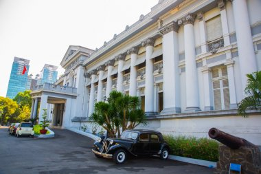 HO CHI MINH CITY, VIETNAM. Gia Long Palace, a Saigon's French colonial architecture, near Ben Thanh Market, now are history museum.Saigon.The car is old.