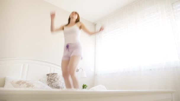 Happy Blond Beautiful Woman jumping On A Bed - Track  Right