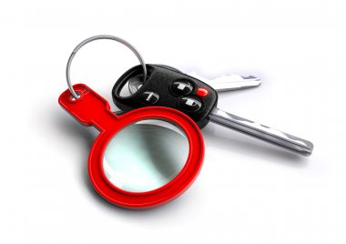 Car keys with a magnifying glass as a keyring