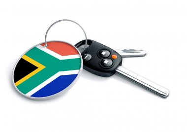 Set of car keys with keyring and country flag. Concept for car prices, buyer or selling a vehicle in South Africa