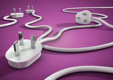 Electical cables and plugs lay on a purple smooth surface and overlap each other. Concept for electricity and power usage by consumers.