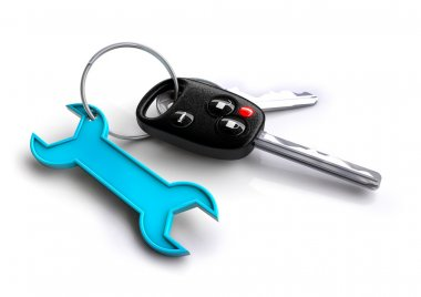 Car keys with blue spanner icon as keyring. Car service and repa