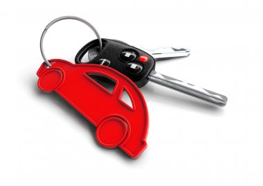 Car keys with orange passenger vehicle icon as keyring.