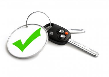Car keys with approved tick symbol on key ring. Concept for appr