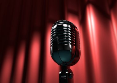 Vintage microphone on stage with red curtains. Moody stage light