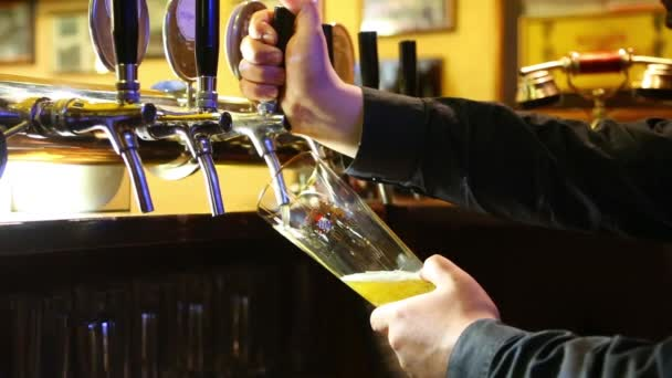 Beer poured from the tap into a glass Carlsberg