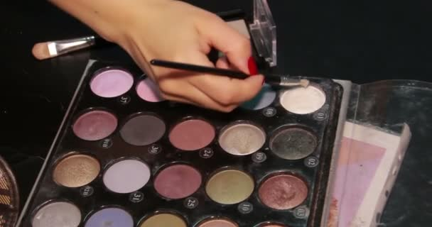 Cosmetics. Eyeshadows. Arm with brush.