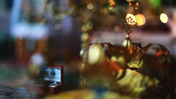 Wedding crowns. Orthodox Church. Close-up focus pull.