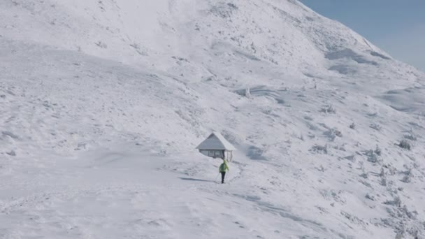 4k slow motion shot of man hiking in snowy and cold mountains during winter season