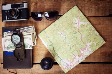 Travel equipment -  map, vintage camera, sunglasses, compass, passport and money stock vector