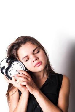 smiley businesswoman holding alarm clock. isolated on white back