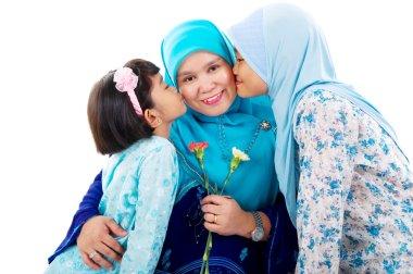 muslim girls kissing mother