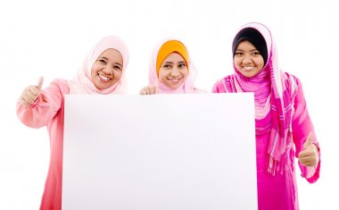 Muslim women holding a white board stock vector