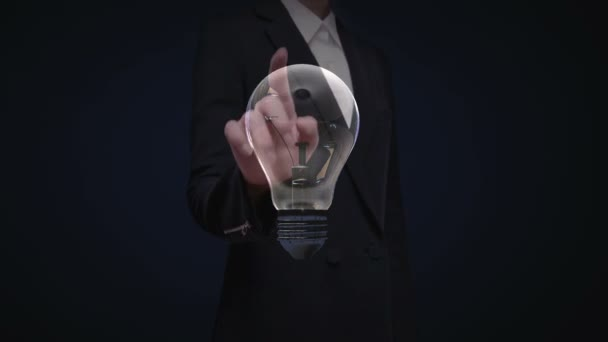 Businesswoman touching shape of light bulb, idea brainstorming concept.