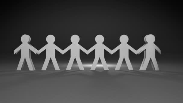 Team von Papierpuppen Menschen halten sich an den Händen und stehen in einer Reihe (enthalten Alpha)