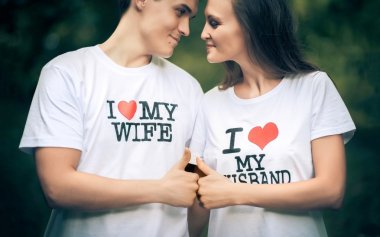 Married couple with words on the T-shirt I love my wife and husband