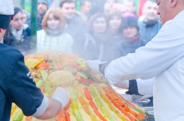 Moscow, Russia - November 11, 2015: Chefs from Morocco prepare a large couscous on the street. Festival of Morocco in Moscow.