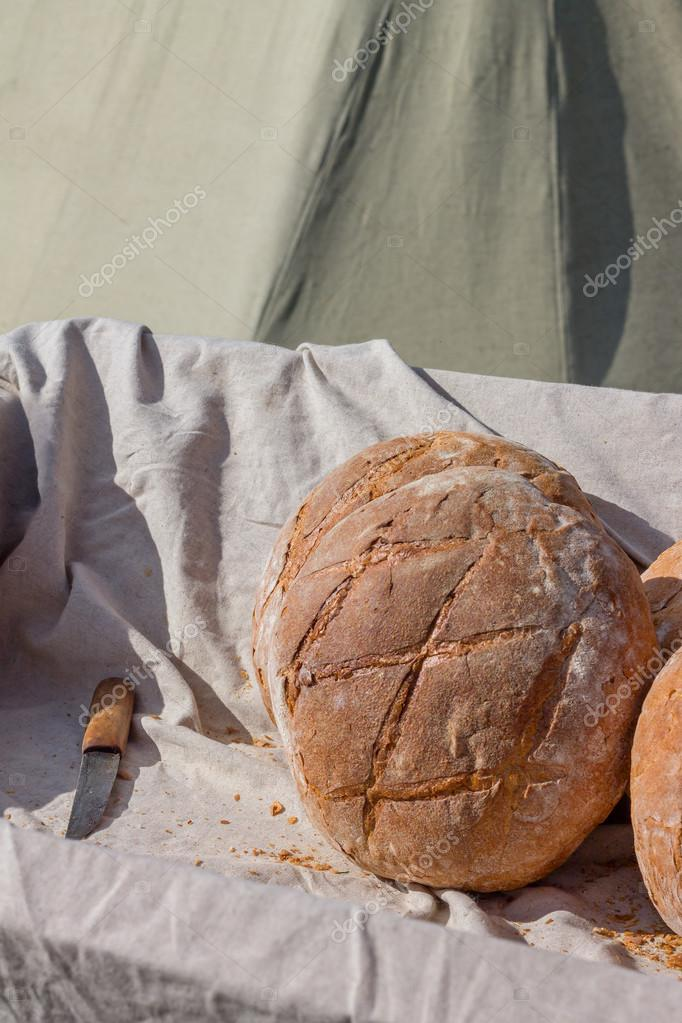 Fresh hearth bread in the cart with knife