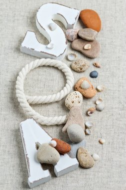 Concept of the summer time with sea shells and stones. Decorativ