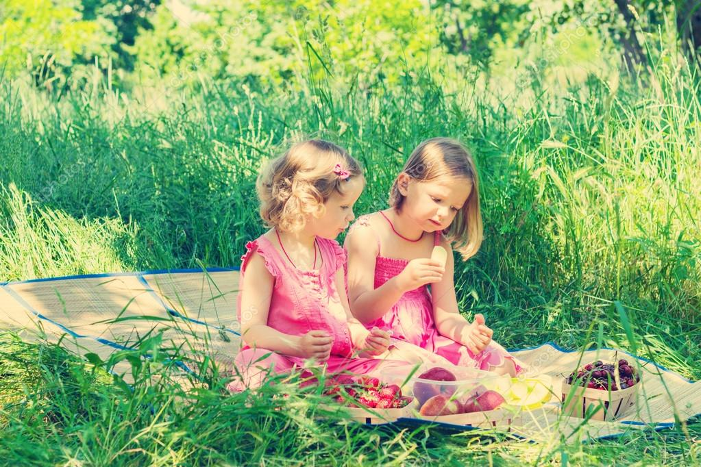 Small cute funny girls sisters at the picnic the image is tin stock photo iuliia29photo - Small tin girl ...