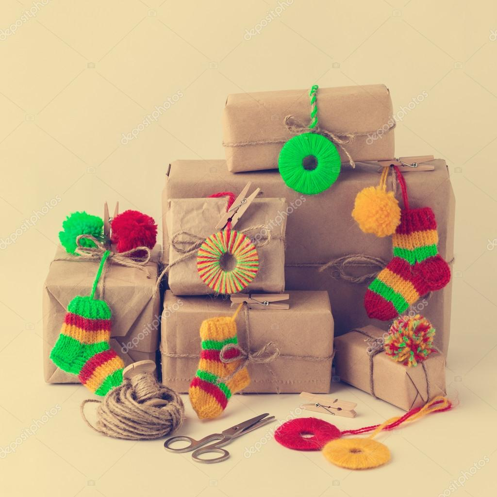 Vintage handmade gifts boxes with small knitted Christmas decora