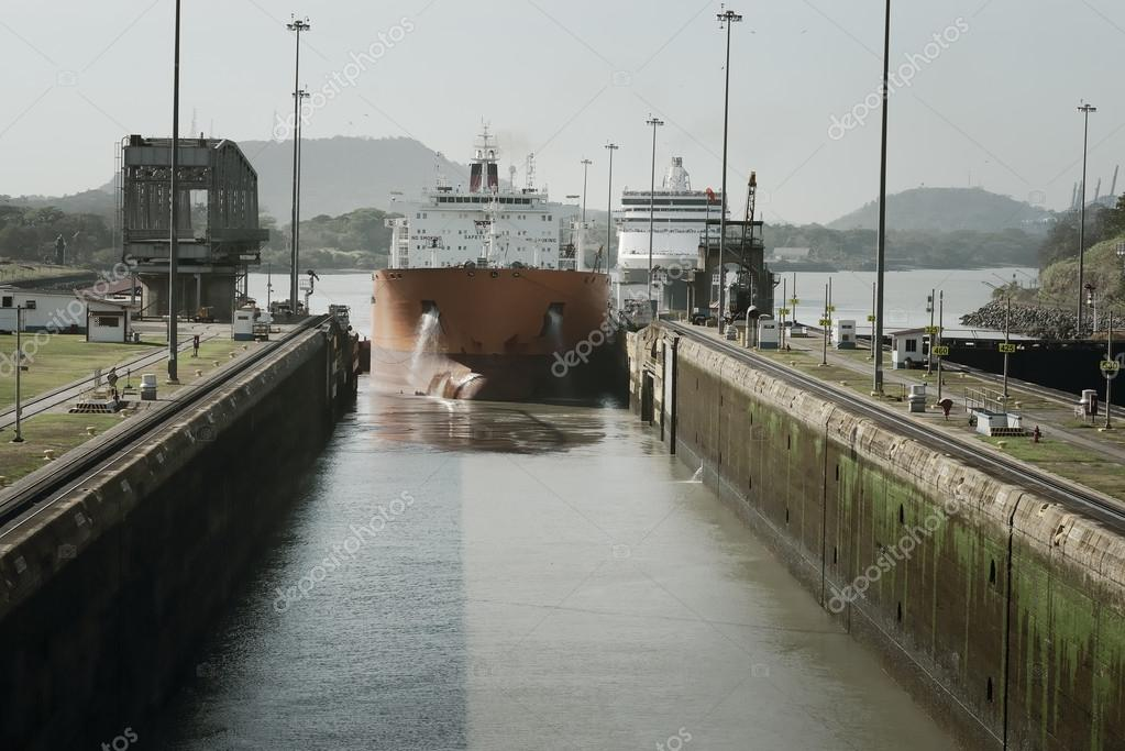 Large cargo ship entering Miraflores Locks at Panama Canal, Panama