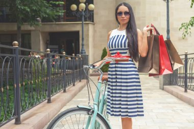 fashion woman dressed in striped dress with bags