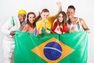 Group multiracial people holding a Brazil flag and international flags.